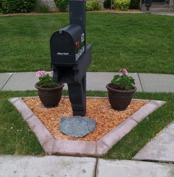 Landscape curbing mailbox